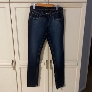 A pair of SUKO jeans in a size 10